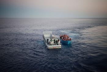 Risking their lives to reach Europe from North Africa, a boatload of people, some of them likely in need of international protection, are rescued in the Mediterranean Sea by the Italian Navy.