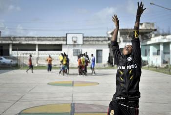 A girl takes a shot during a basketball training session in Mogadishu, Somalia.