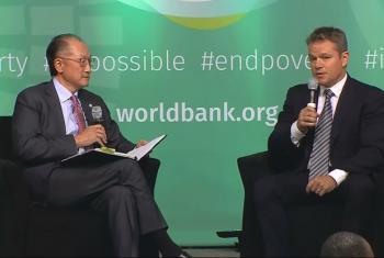 Jim Yong Kim (left) and Matt Damon.