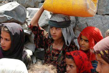 Girls fetching water in Mawyah district, Taiz. This role often falls on the shoulders of girls and young women, often at the expense of their education. (file)