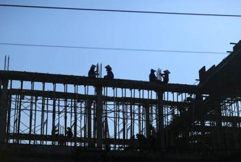Workers at a construction site in Binh Thuan province, Viet Nam.