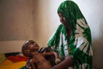 A two year-old child cries for his mother at the Kismayo general hospital in Somalia.