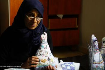 Syrian refugee Amina, 56, embroiders dolls that embody the dreams of those affected by war, in Shatila Camp, Beirut.© UNHCR/Houssam Hariri
