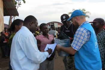 UNHCR staff at Mussungue reception centre, north-west Angola, distribute food supplies including maize, rice, beans, oil, salt and sardines to Congolese refugees who fled an eruption of violence in Kasai region.