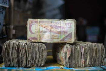 Bundles of Somali shilling notes are seen at a money exchanger's stall on the streets of the capital Mogadishu. Millions of people in the Horn of Africa nation rely on money sent from their relatives and friends abroad in the form of remittances in order