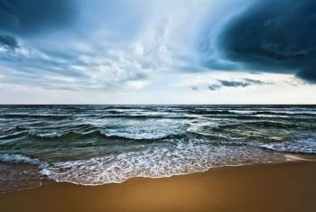 By absorbing much of the added heat trapped by atmospheric greenhouse gases, the oceans are delaying some of the impacts of climate change.