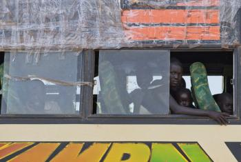 Refugees arriving at Imvepi settlement on a bus from the South Sudan border.