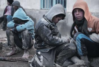 Tired children gather in the courtyard of a house after fleeing fighting between ISIS and Iraqi security forces in Tall Kaysumah, west of Mosul, Iraq, Saturday 4 March 2017. From there, they would be taken to a camp for internally displaced people.