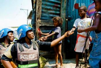 Members of a Formed Police Unit serving with the UN Stabilization Mission in Haiti (MINUSTAH) patrol a neighborhood in the capital, Port-au-Prince. UN File Photo/Marco Dormino