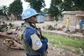 A Police Commissioner joins the first patrol by MINUSCA in Bangui, capital of the Central African Republic .