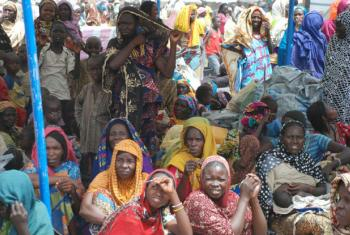 Nigerian refugees returning from Cameroon wait to register at Banki camp in northern Nigeria. Photo UNHCR/Romain Desclous