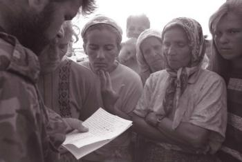 In 1995, a government soldier reads out the names of soldiers who are confirmed survivors or escapees from the fallen city of Srebrenica. UNICEF/NYHQ1995-0553/LeMoyne