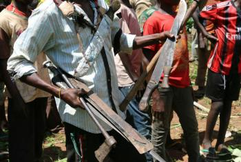An anti-Balaka commander collects weapons handed in by the group during a release ceremony in Bambari in the Central African Republic.