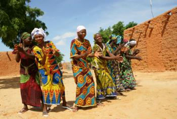 Goal 1: End poverty in all its forms everywhere. Girls are playing and singing in groups in the Garin Badjini village, south east of Niger.