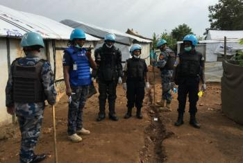 UNPOL officer in South Sudan, Cynthia Anderson, leads a team on a search of shelters in displaced persons camp in Juba.