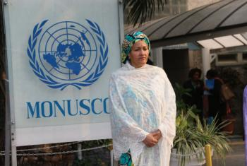 Deputy Secretary-General Amina Mohammed standing in front of the Office of the UN Stabilization Mission in the DRC.