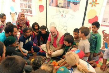 UNICEF Representative in Syria Fran Equiza (centre), speaks with children at the Mabrouka camp in Ein Issa, northern Syria.