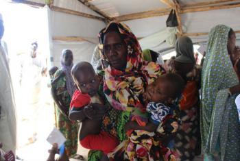 A mother with her children in Monguno, Borno state, northeast Nigeria. (file)