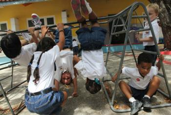 Children play outdoors at a school in Curaçao.