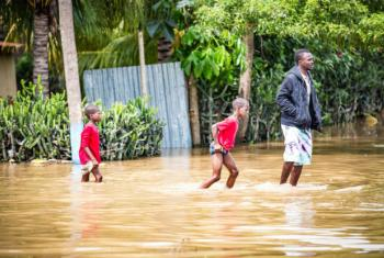 On 8 September 2017 in Haiti outside the town of Ouanaminthe, children wade through the flood waters where several small villages suffered significant damages caused by Hurricane Irma, houses are flooded and many people have lost their belongings. © UNICE