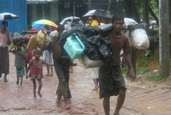 Rohingya refugees trudge through the rain and mud as they arrive at Kutupalong camp in Bangladesh after days on foot.