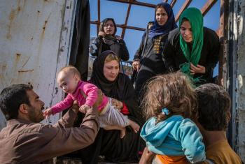 Iraqi IDP's, mainly from Gogjali on the Eastern outskirts of Mosul, arrive at the UNHCR run Hasansham camp.