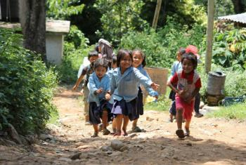 Young children play outside after the school day ends in rural Nepal.