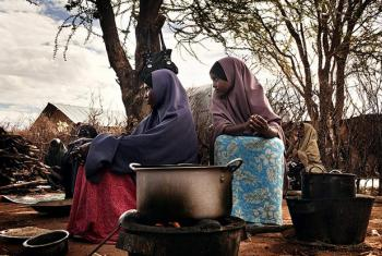 Refugees cook a meal in Dadaab camp, Kenya.
