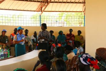 Assistant Inspector of Police Annah Chota (center left) meeting women in Abyei.