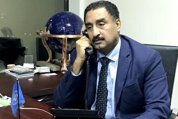 Hashim Hussein, head of UNIDO's Investment, Technology and Promotion office in Bahrain on the phone with UN News.
