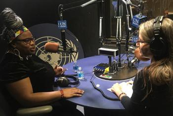 Grizelda Grootboom speaking with Cristina Silveiro in the radio studio at UN Headquarters in NY. UN News/Matt Wells