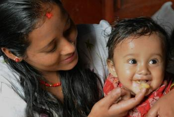 A mother feeds her son healthy complementary foods in the Dolakha district in Nepal. On Wednesday WHO released new guidelines to address overweight and obesity in children. © 2013 Valerie Caldas, Courtesy of Photoshare