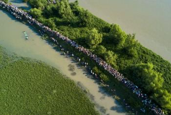 An aerial shot shows thousands of new Rohingya refugee arrivals crossing the border near Anjuman Para village, Palong Khali, Bangladesh.