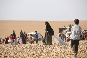 The UN continues to be alarmed over the impact of fighting on the Syrian people. Here are displaced children and adults seen after fleeing from ISIL-controlled areas in rural Raqqa, Syria.
