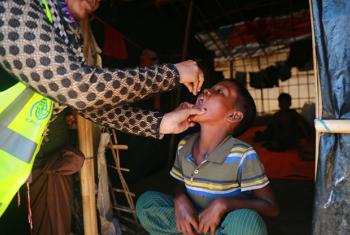 A Rohingya boy receives one of the first Cholera vaccine doses at a UN Migration Agency(IOM) clinic in Jumbali, in the world's second largest mass immunization for the disease which started this morning.