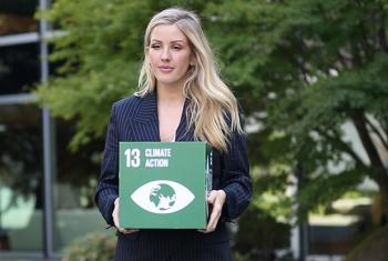 British singer Ellie Goulding stands for climate action at UN Headquarters in New York.