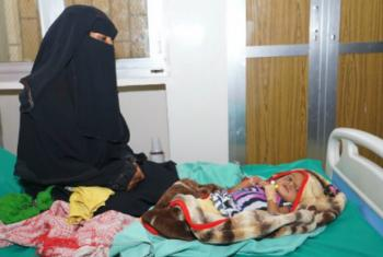 A mother and her child in war-torn Yemen, where people are also coping with the fastest growing cholera epidemic ever recorded.
