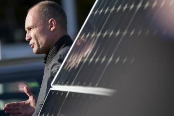 """Bertrand Piccard speaking in Geneva where he said that """"solutions exist"""" to reduce global warming which governments should view as an investment, not a cost."""