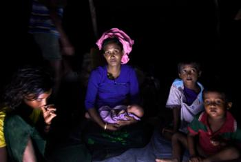 Rohingya refugee Mubina Khatun was nine months pregnant when she fled her home in Myanmar. She gave birth to her daughter nine days ago on the Bangladesh-Myanmar border. © UNICEF/UN0144602/Brown