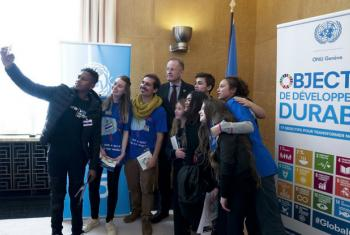 Kids United's Gabriel organises a selfie with UN Geneva Director-General Michael Møller as part of the #KidsTakeover event to mark World Children's Day.