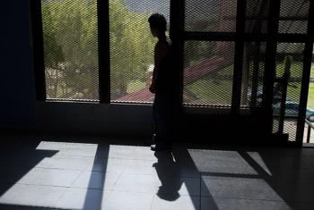 A 15-year-old-boy looks out of the UNICEF-supported National Foundation for Honduran Development, in Honduras. The Foundation supports children and young people in the area who are affected by gang violence.
