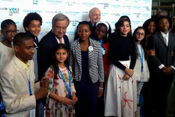 Emmanuel Elisha Ford (first boy on the left) and other children with the UN Secretary General before the World Children's Day at UN Headquarters.