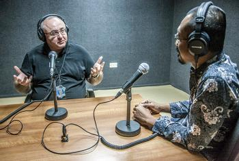 Zurab Elzarov  (left) speaking with Setyo Budi at UNAMID radio studio in Darfur.