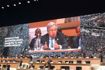 Secretary-General António Guterres (on screen) addresses the One Planet Summit in Paris.