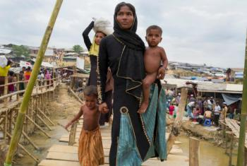 Rohingya refugees make their way to their new homes with essential supplies given from a distribution centre in Kutupalong camp.