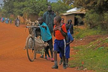 Refugee children from the Democratic Republic of the Congo walk to school in Uganda's Kyangwali Refugee settlement in Hoima District.