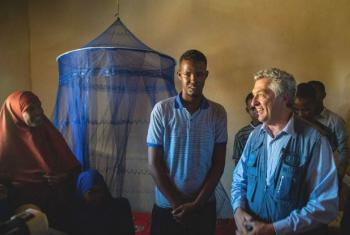 UN High Commissioner for Refugees Filippo Grandi visits the newly built shelter home of a Somali returnee in Kismayo, southern Somalia.
