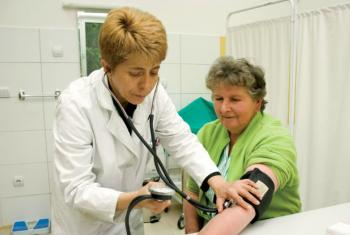 A health-care professional takes a patient's blood pressure.