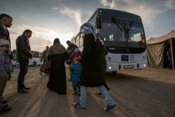 Migrants boarding the bus headed towards the processing center in Amman, Jordan. (file)