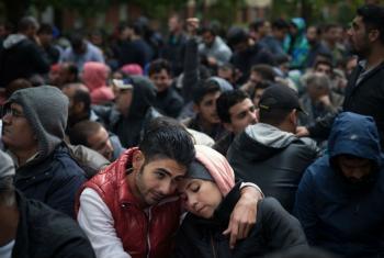 Migrants wait in line to be registered in Berlin, Germany.
